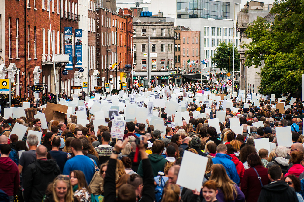 """Dublin, Ireland. 26th August, 2018. <br /> Participants of the Stand4Truth protest march to the sites of previous laundries in Dublin city centre during the celebration of the Mass in the second of the two-days of the visit of Pope Francis in Dublin, Ireland.<br /> Pope Francis has made a two-day visit to the Republic of Ireland by celebrating a Mass at Dublin's Phoenix Park. The Argentine Pope asked forgiveness for the """"abuses in Ireland, abuses of power, conscience and sexual abuses"""" perpetrated by Church leaders. It was the first papal visit to Ireland for 39 years. During his activities many activists, victims and survivors have made protests and a silent march Garden of Remembrance towards the last Magdalene Laundry to close in Ireland.<br />  © Simone Padovani"""