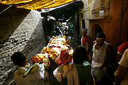 Bodies arrive day and night from far and near to be cremated at Jalasi Ghat, the cremation grounds at Manikarnika Ghat. One hundred or more times a day male family members carry a loved one's body through the narrow streets on a bamboo litter to the Ganges River shore, a place of pilgrimage for Hindus during life, and at death.