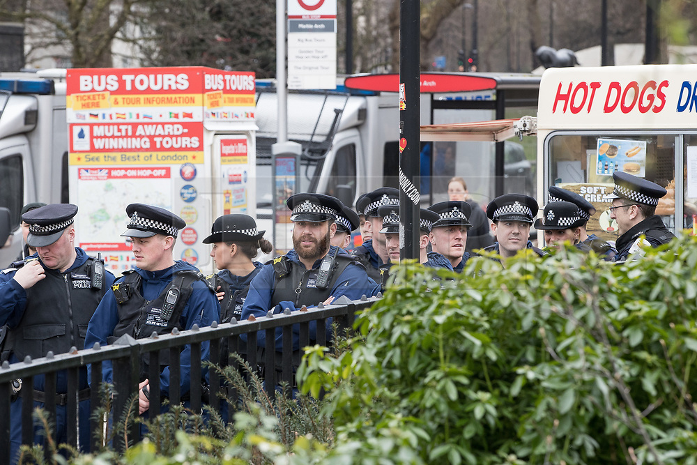 """© Licensed to London News Pictures. 11/03/2018. London, UK. A serial of police at the demonstration . Alt right group Generation Identity and other far-right groups hold a demonstration at Speakers' Corner in Hyde Park , opposed by antifascists . Generation Identity supporters Martin Sellner and Brittany Pettibone were due to speak at the demo but were arrested and detained by police when they arrived in the UK , also forcing them to cancel an appearance at a UKIP """" Young Independence """" youth event , which in turn was reportedly cancelled amid security concerns . Photo credit: Joel Goodman/LNP"""