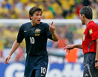 Photo: Glyn Thomas.<br />Brazil v Australia. Group F, FIFA World Cup 2006. 18/06/2006.<br /> Australia's Harry Kewell (L) angrily confronts referee Markus Merk (R) after the full-time whistle.