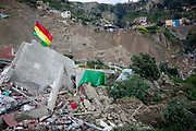 Bolivian flag flies amid ruined houses and rubble, after a major lansdlide in La Paz in 2011 made around 25,000 people homeless, due to heavy rain and poor infrastructure, there were no fatalities and only minor injuries sustained.