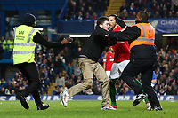 Football - 2012 / 2013 Capital Cup Semi Final - 1st Leg - Chelsea vs Swansea City<br /> Swansea City's Chico Flores held the pitch invader until stewards arrived at Stamford Bridge, London