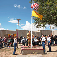 David McLaughlin the Tohatchi High School Color Guard group leader and the color guard holds a moment of remembrance for the students of Tohatchi High School Wednesday, Sept. 11.