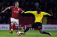 Gustav Engvall of Bristol City (L) is tackled by Christian Kabasele of Watford (R). The Emirates FA Cup, 3rd round match, Watford v Bristol City  at Vicarage Road in Watford, London on Saturday 6th January 2018.<br /> pic by Steffan Bowen, Andrew Orchard sports photography.