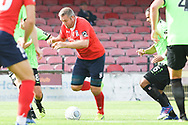 Jon Parkin of York City (9) holds the ball up and looks to shoot during the Vanarama National League North match between York City and Curzon Ashton at Bootham Crescent, York, England on 18 August 2018.
