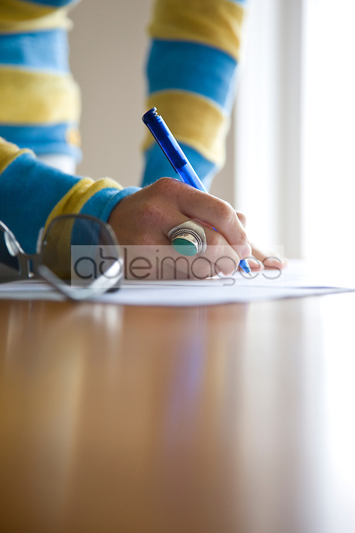 Close up of a woman hands signing documents