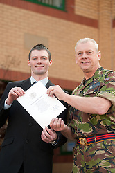 Simon Brigham from Wakefield joined 11 Barnsley area recruits today taking one of the first steps towards becoming a professional soldier (23 March). In a special ceremony watched by family and friends they took the Oath of Allegiance at Barnsley TA Centre. Simon seen here receiving his certificate from Major Keith Tomlinson will now move on to basic training then Job specific training..23 March 2011.Images © Paul David Drabble