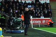 Jose Mourinho, the Chelsea manager looks on. Barclays Premier League match, Swansea city v Chelsea at the Liberty Stadium in Swansea, South Wales on Saturday 17th Jan 2015.<br /> pic by Andrew Orchard, Andrew Orchard sports photography.