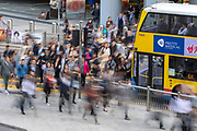 Pedestrians on their way to work in Hong Kong city.