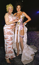 Left to right, top designer VIVIENNE WESTWOOD with model CHANDRA NORTH at a party in London on 25th June 1998.MIU 132