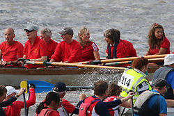 """© Licensed to London News Pictures. 12/09/2015. Television newsreader and personality Sophie Raeworth was seen on board the """"skerry"""" St Helena in the Great River Race. Hundreds of traditional craft have taken to the Thames for the annual Great River Race. The 21 mile rowing race fom Millwall to Richmond is known as London's river marathon. Credit : Rob Powell/LNP"""