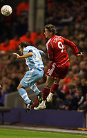 Photo: Paul Greenwood.<br />Liverpool v Marseille. UEFA Champions League, Group A. 03/10/2007.<br />Liverpool's Fernando Torres,right, beats Laurent Bonnart in the air
