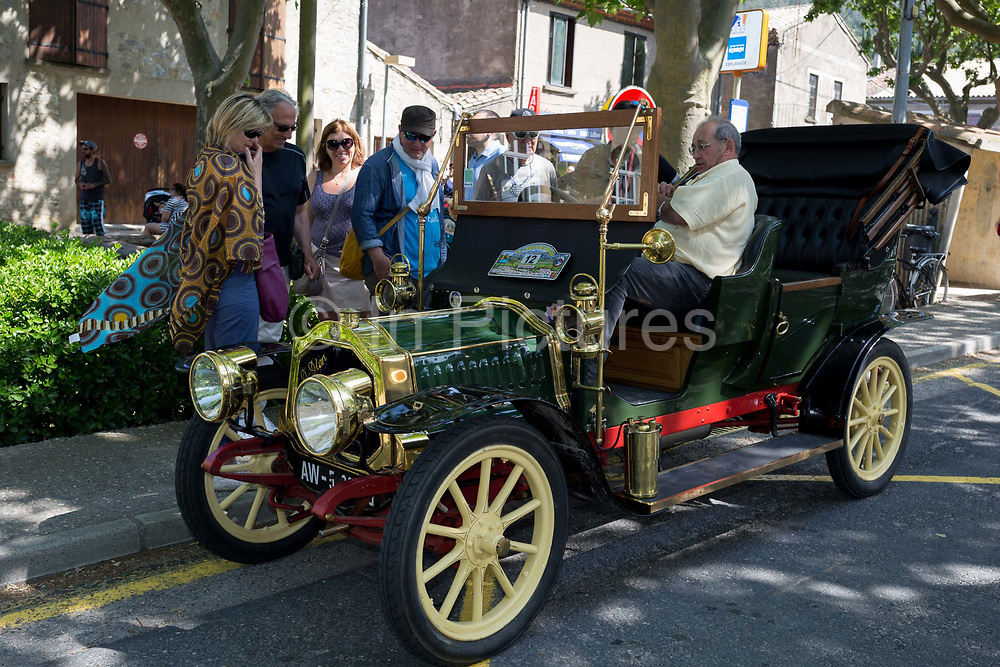 A visiting vintage car in a French village, during a three-day rally journey through the Corbieres wine region, on 26th May, 2017, in Lagrasse, Languedoc-Rousillon, south of France. Lagrasse is listed as one of Frances most beautiful villages and lies on the famous Route 20 wine route in the Basses-Corbieres region dating to the 13th century.