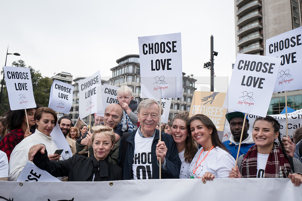 © Licensed to London News Pictures. 17/09/2016. London, UK. Lord ALFRED DUBS (centre), who was brought to Britain on the Kindertransport during the Second World War, joins thousands as they march through central London to call on the government to welcome refugees to the UK. Photo credit: Rob Pinney/LNP