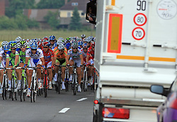 Peloton and a truck during 1st stage of the 15th Tour de Slovenie from Ljubljana to Postojna (161 km) , on June 11,2008, Slovenia. (Photo by Vid Ponikvar / Sportal Images)/ Sportida)