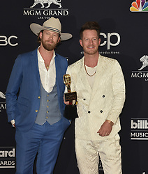 May 1, 2019 - Las Vegas, NV, USA - LAS VEGAS, NEVADA - MAY 01: (L-R) Brian Kelley and Tyler Hubbard of Florida Georgia Line pose with the award for Top Country Song for 'Meant to Be' in the press room during the 2019 Billboard Music Awards at MGM Grand Garden Arena on May 01, 2019 in Las Vegas, Nevada. Photo: imageSPACE (Credit Image: © Imagespace via ZUMA Wire)