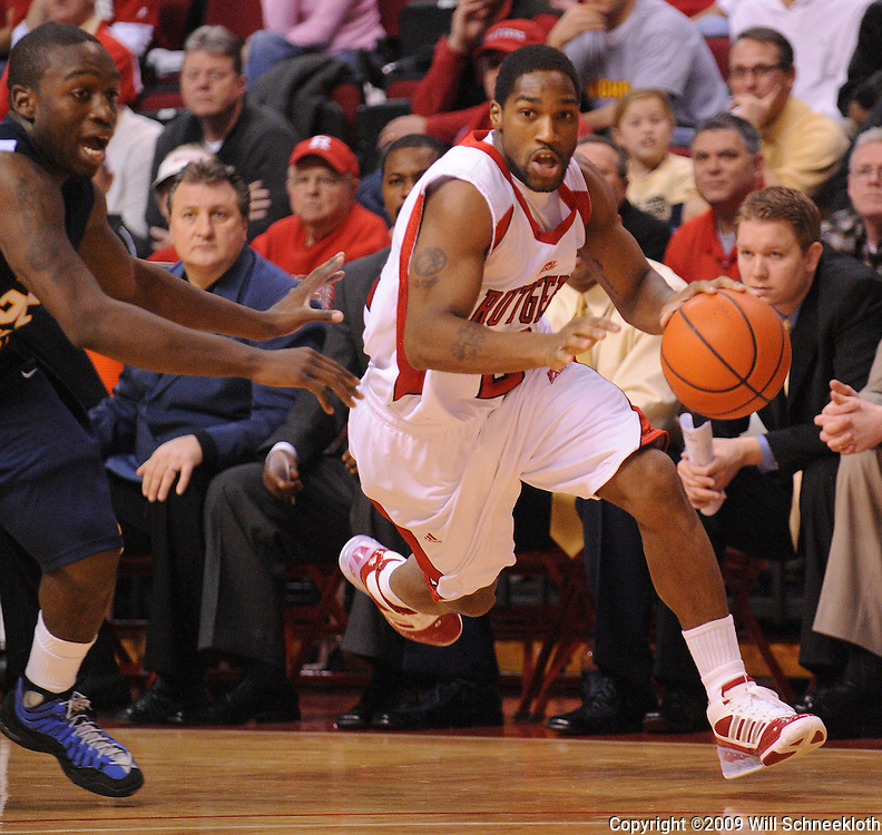 Feb 22, 2009; Piscataway, NJ, USA; Rutgers guard Anthony Farmer (2) drives to the net against West Virginia guard Darryl Bryant (25) during the first half of Rutgers' 74-56 loss to West Virginia at the Louis Brown Athletic Center.