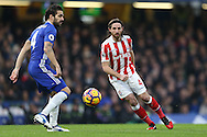 Joe Allen of Stoke City passes the ball past Cesc Fabregas of Chelsea. Premier league match, Chelsea v Stoke city at Stamford Bridge in London on Saturday 31st December 2016.<br /> pic by John Patrick Fletcher, Andrew Orchard sports photography.