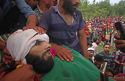 July 4, 2017 - Srinagar, Jammu and Kashmir, India - (EDITOR NOTE: Image depicts death.) Thousands of people attend the funeral prayers of Jehangir Ahmad Khanday of Keller area of Shopian district on Tuesday.. six homes were destroyed during a gunfight in which three rebels were killed, and one Indian Army officer and one paramilitary officer were injured, as well as dozens of protesters injured. (Credit Image: © Umer Asif/Pacific Press via ZUMA Wire)