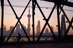 Dawn view through Waibaidu Bridge towards modern skyline of Pudong in Shanghai