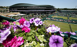 A general view of court 14 on day two of the Wimbledon Championships at the All England Lawn Tennis and Croquet Club, Wimbledon.