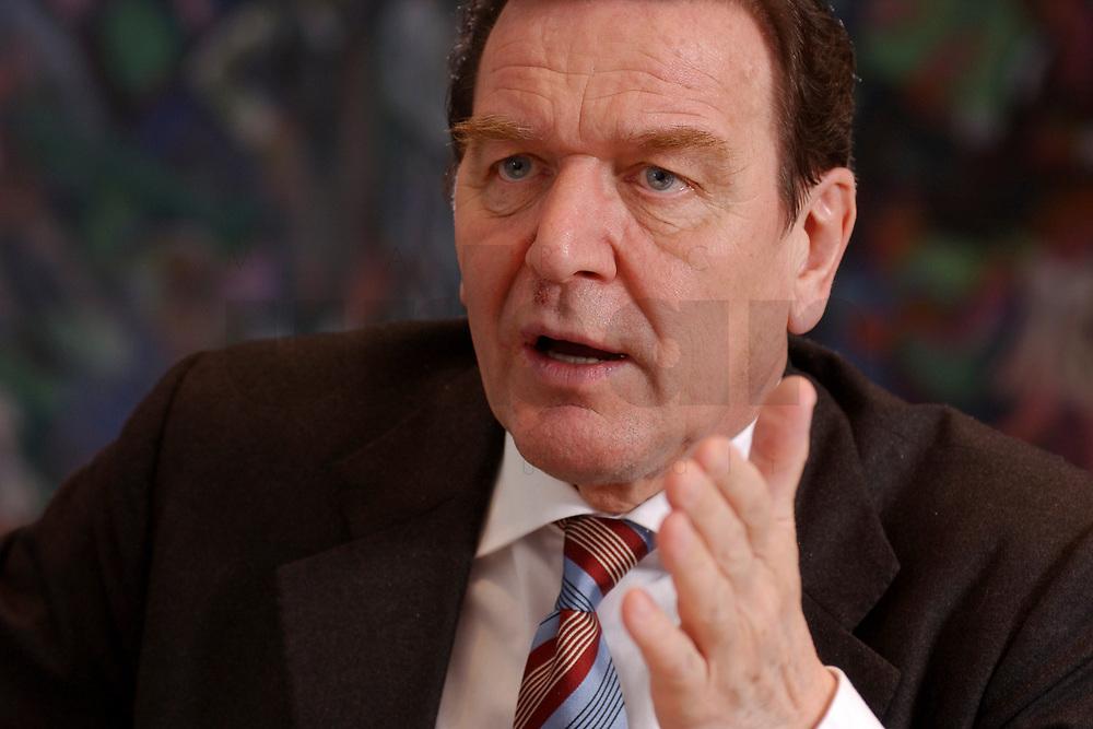 09 JAN 2002, BERLIN/GERMANY:<br /> Gerhard Schroeder, SPD, Bundeskanzler, waehrend einem Interiew, in seinem Buero, Bundeskanzleramt<br /> Gerhard Schroeder, SPD, Federal Chancellor of Germany, during an interview, in his office<br /> IMAGE: 20020109-02-014<br /> KEYWORDS: Gerhard Schröder
