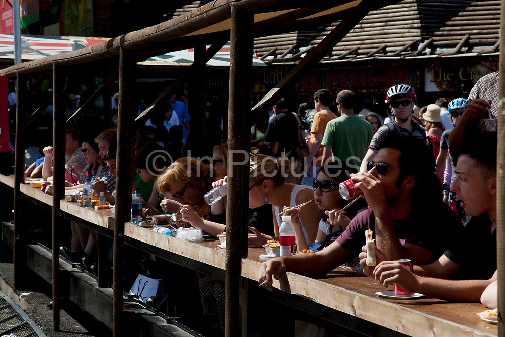 Busy summer day at Camden Market Village, North London. Camden Lock is a crowded hang out for young Londoners.