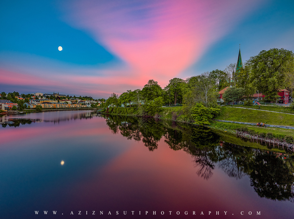 www.aziznasutiphotography.com                                         Picture has been taken in a very beautiful Midnigh Sunset in TRondheim from Gamlebybro Towards the Nidelven terrasse . NTNU main building and Moon on the Sky make is more beautiful.