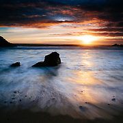 Waves move on shore as the sun sets along the Big Sur Coast in California.