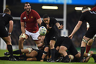 Aaron Smith of New Zealand passes the ball. Rugby World Cup 2015 quarter-final match, New Zealand v France at the Millennium Stadium in Cardiff, South Wales  on Saturday 17th October 2015.<br /> pic by  Andrew Orchard, Andrew Orchard sports photography.