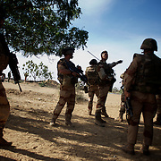 January 19, 2013 - Markala, Mali: French Army men take defensive position in the outskirts of Markala, in preparation for an advance towards the northern city of Diabaly, under siege by islamist militants since the 14th of January.<br /> <br /> Several insurgent groups have been fighting a campaign against the Malian government for independence or greater autonomy for northern Mali, an area known as Azawad. The National Movement for the Liberation of Azawad (MNLA), an organisation fighting to make Azawad an independent homeland for the Tuareg people, had taken control of the region by April 2012.<br /> <br /> The Malian government pledge to the French army to help the national troops to stop the rebellion advance towards the capital Bamako. The french troops started aerial attacks on rebel positions in the centre of the country and deployed several hundred special forces men to counter attack the advance on the ground. (Paulo Nunes dos Santos)