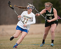 Gilford's Cassidy Bartlett gets around Hopkinton's Callie Chase during NHIAA DIvision III Lacrosse Friday afternoon at Gilford Meadows Field.  (Karen Bobotas/for the Laconia Daily Sun)