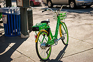 2018 FEBRUARY 12 - Lime Bike E, the electric version, parked on a sidewalk in downtown Seattle, WA, USA. By Richard Walker