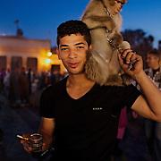 A street performer with his monkey at enjoying a short break.