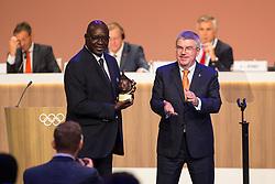 LIMA, Sept. 16, 2017  International Olympic Committee (IOC) President Thomas Bach (R) congratulates IOC honour member Youssoupha Ndiaye during the 131st IOC session in Lima, Peru, on Sept. 15, 2017. The 131st IOC session concluded on Friday. (Credit Image: © Li Ming/Xinhua via ZUMA Wire)