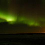 Aurora borealis, also known as Northern Lights dance in the sky. Cape Churchill, Manitoba. Canada.