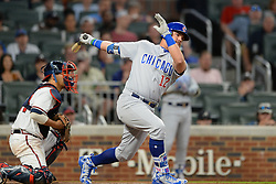 May 15, 2018 - Atlanta, GA, U.S. - ATLANTA, GA Ð MAY 15:  Cubs outfielder Kyle Schwarber (12) drives a ball deep during the game between Atlanta and Chicago on May 15th, 2018 at SunTrust Park in Atlanta, GA. The Chicago Cubs beat the Atlanta Braves by a score of 3 Ð 2.  (Photo by Rich von Biberstein/Icon Sportswire) (Credit Image: © Rich Von Biberstein/Icon SMI via ZUMA Press)