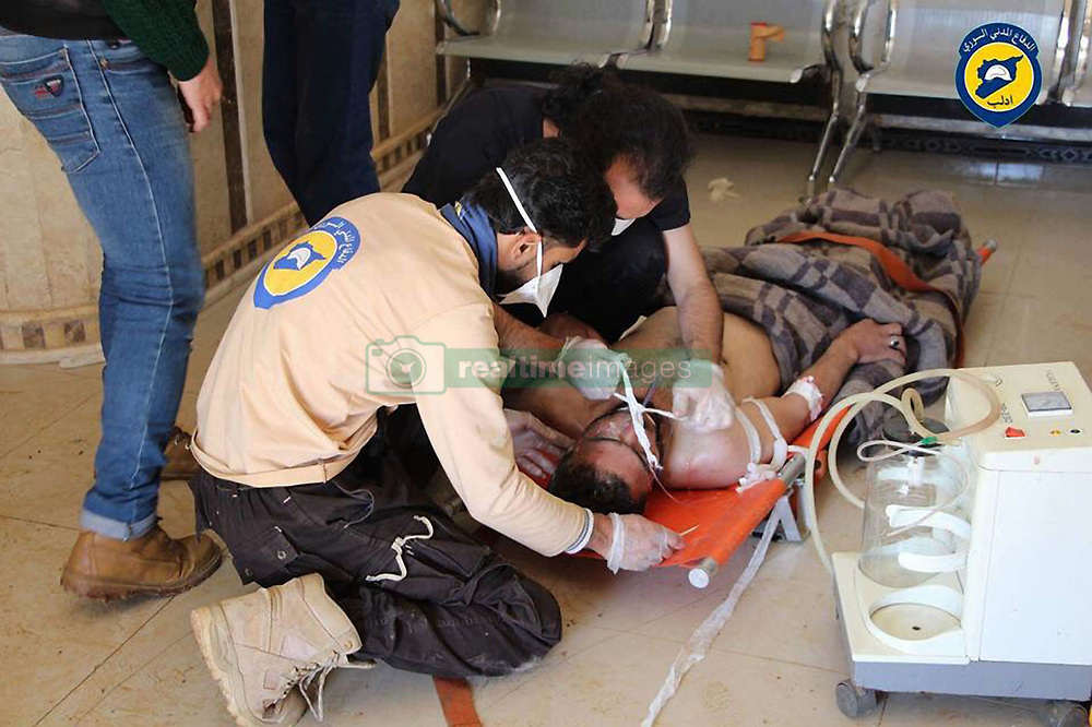 April 4, 2017 - Khan Sheikhoun, Idhib Province, Syria - Syrian Civil Defense aka the White Helmets, helping a victim, after morning attack of a suspected serious lethal gas (most likely sarin nerve gas), in rebel-held Idlib Province in northwestern Syria, near Turkey (population 165,000). A score wounded and over dozen already dead, others might die shortly as a after effect of exposure to deadly gases. The inhabitants are overwhelmingly Sunni Muslims, although there is a significant Christian minority. (Credit Image: © Syria Civil Defense via ZUMA Wire)