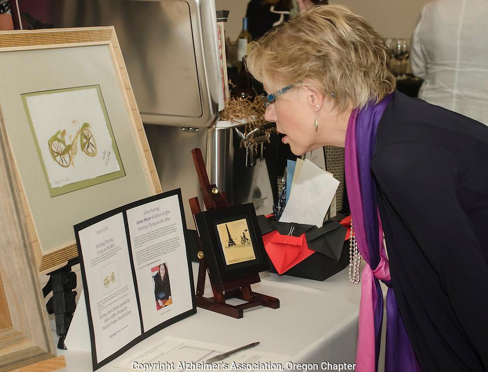 Attendee looks over auction items at an Oregon Alzheimer's Association fundraiser.