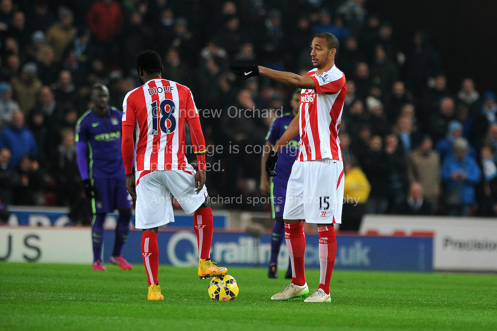 Stoke city players Steven Nzonzi (15) chats to teammate Mame Diouf as they prepare for k/o. Barclays Premier League match, Stoke city v Manchester city at the Britannia Stadium in Stoke on Trent , Staffs on Wed 11th Feb 2015.<br /> pic by Andrew Orchard, Andrew Orchard sports photography.