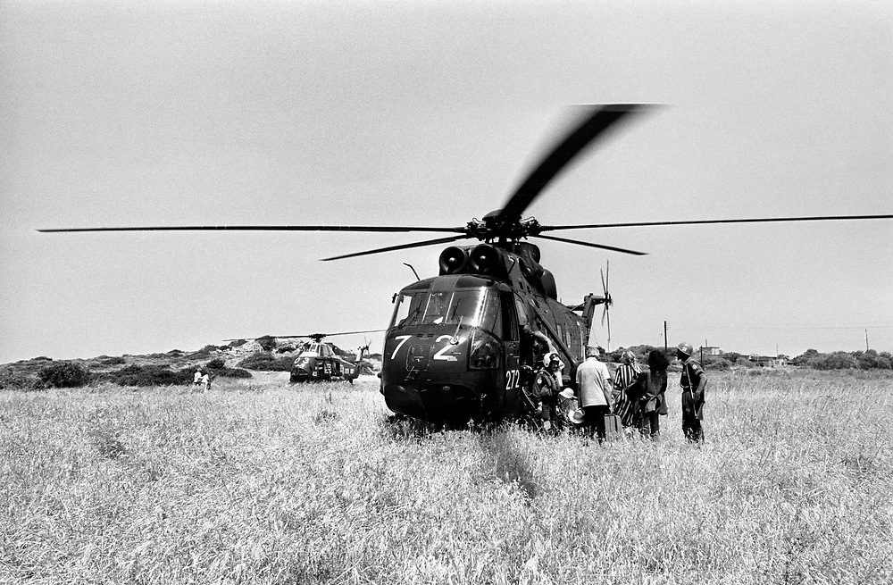 Cyprus War 20 July-18 August 1974. Turkish invasion of Cyprus code-name by Turkey, Operation Attila. British holiday makers are evacuated by a Royal Navy Sea King helicopter from HMS Hermes near Kyrenia July 1974. Photo by Terry Fincher.