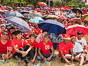 01 NOVEMBER 2015 - YANGON, MYANMAR: The crowd waits for Aung San Suu Kyi at the NLD's last election rally of the 2015  election in the Yangon suburbs Sunday. Political parties are wrapping up their campaigns in Myanmar (Burma). National elections are scheduled for Sunday Nov. 8. The two principal parties are the National League for Democracy (NLD), the party of democracy icon and Nobel Peace Prize winner Aung San Suu Kyi, and the ruling Union Solidarity and Development Party (USDP), led by incumbent President Thein Sein. There are more than 30 parties campaigning for national and local offices.    PHOTO BY JACK KURTZ