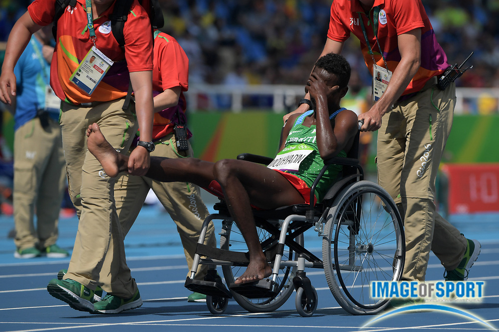 Aug 16, 2016; Rio de Janeiro, Brazil;  Abdi Waiss Mouhyadin (DJI) is helped off the track during the men's 1500m preliminaries in the Rio 2016 Summer Olympic Games at Estadio Olimpico Joao Havelange.