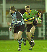Photo Peter Spurrier<br /> 07/12/2002<br /> European Rugby - Heineken Cup Northamton vs Cardiff.<br /> Nick Beal with ball looks to find away to attack down the wing
