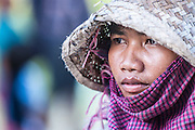 A Khmer woman works in the sweltering heat.