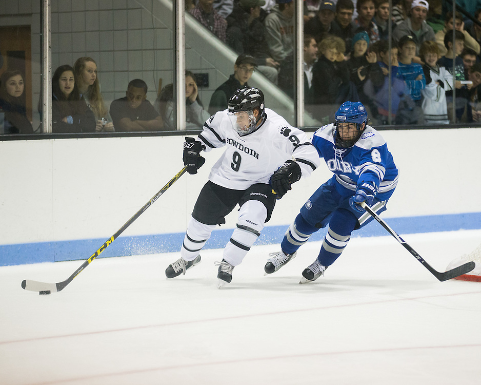 Bowdoin College Defenseman Jason Cahoon (9) and Colby College Forward Devin Albert  (8) during a NCAA Division III hockey game between Colby College and Bowdoin College on December 5, 2015 at Sidney J. Watson Arena on the campus of Bowdoin College in Brunswick, ME.  (Dustin Satloff)