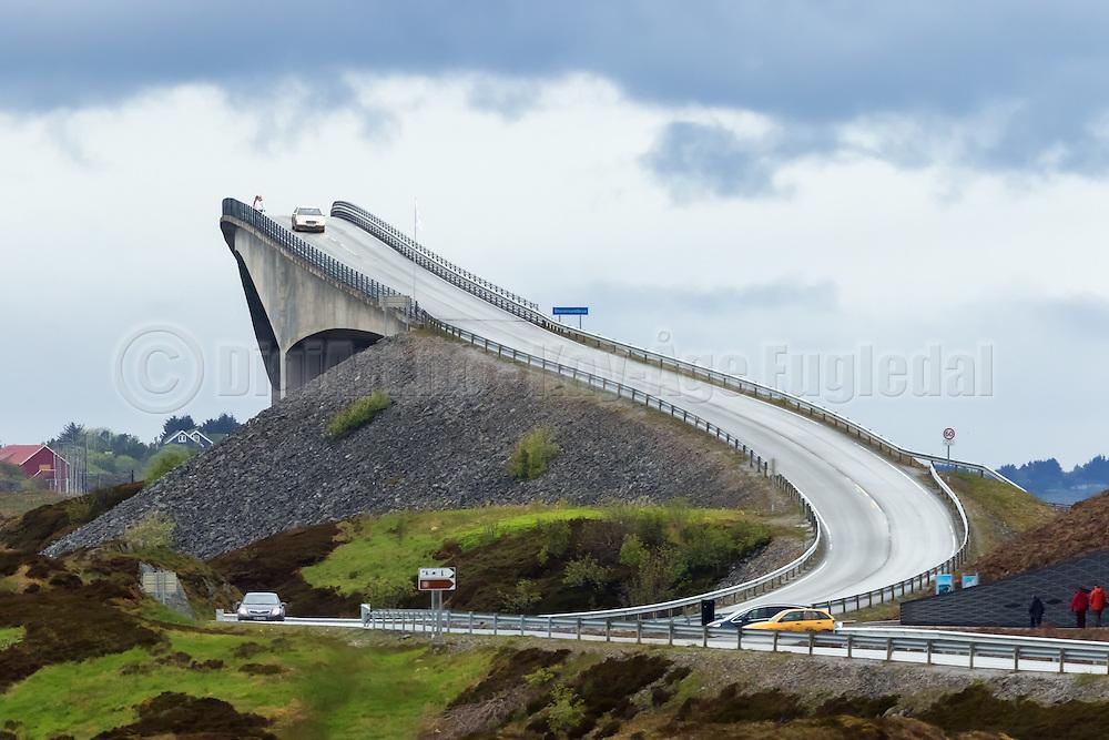 This road looks like the road to heaven, but it is not. The bridge is called Storseisundbrua, and is one of several bridges in a road system named Atlanterhavsveien, located on the west coast of Norway   Dette ser nesten ut som veien til himmelen, men det er den bratte Storseisundbrua, som er en del av Atlanterhavsveien.