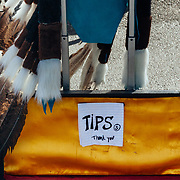 The tip bin of a street artist draws with chalk near the Space Needle in Seattle, Washington.