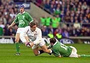 Photo. Richard Lane. <br /> England v Ireland at Twickenham. Lloyds TSB Six Nations Championship.<br /> 16-2-2002<br /> Jonny Wilkinson gets the ball away as Girvan Dempsey tackles.