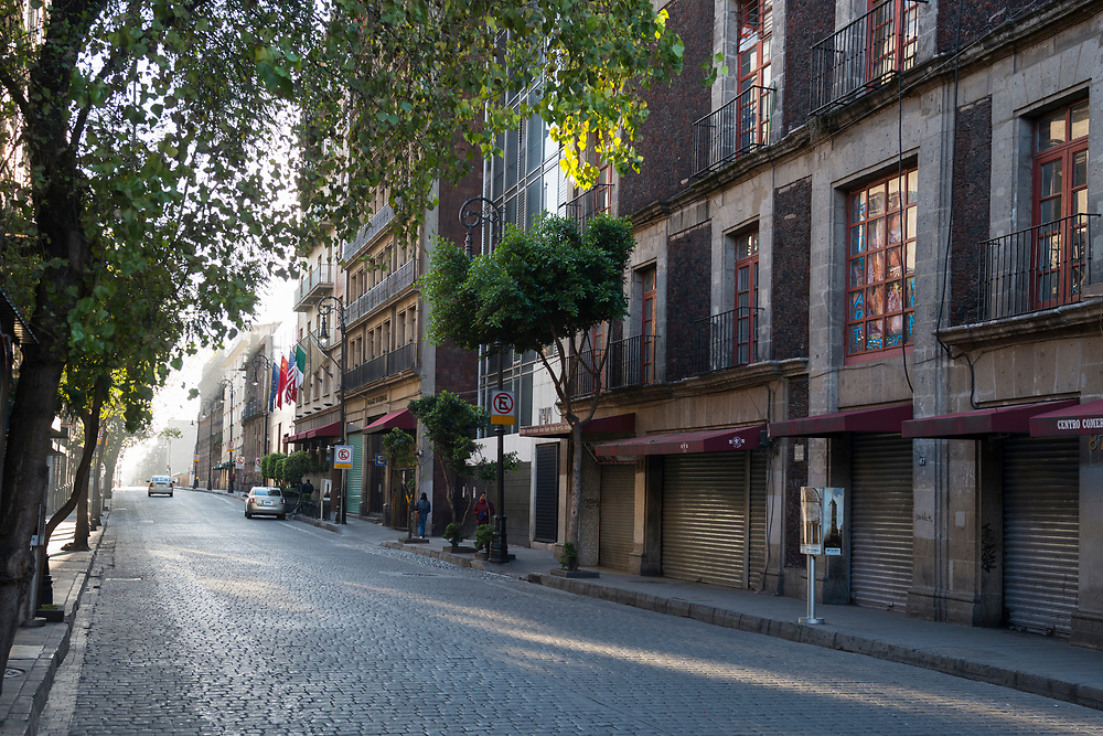Early morning scene with light vehicular and pedestrian traffic in the Centro Historico area of Mexico City, Mexico.